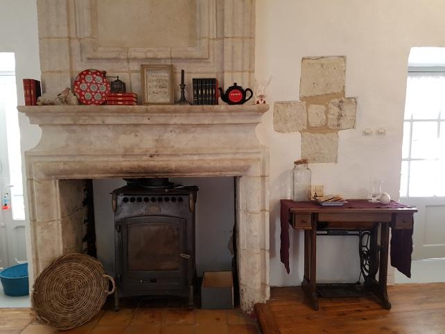 Stone fireplace with Godin wood burner